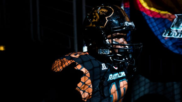 Rattlers' Ronnell Pompey (18) waits in the tunnel to