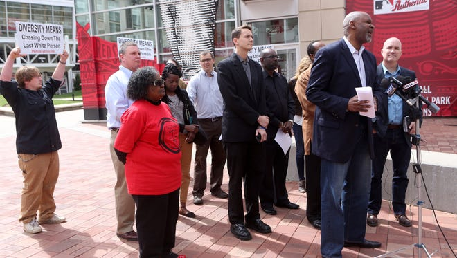 Reverend Damon Lynch III speaks during a press conference outside of Great American Ball Park. It was interrupted by several members of the Traditionalist Youth Network yelling conflicting remarks at the speakers.