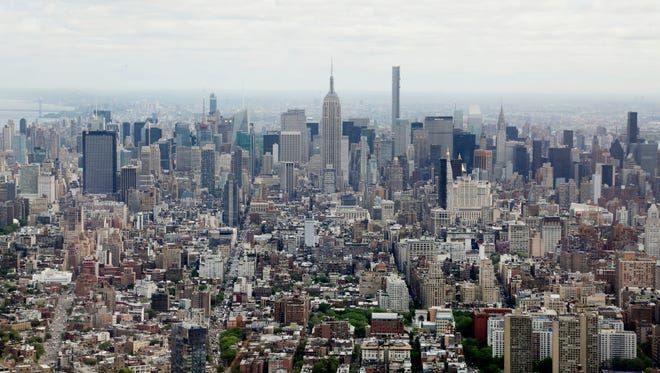 Midtown Manhattan, including the Empire State Building (center), is seen from the observatory at One World Trade Center, on May 20, 2015, in New York.