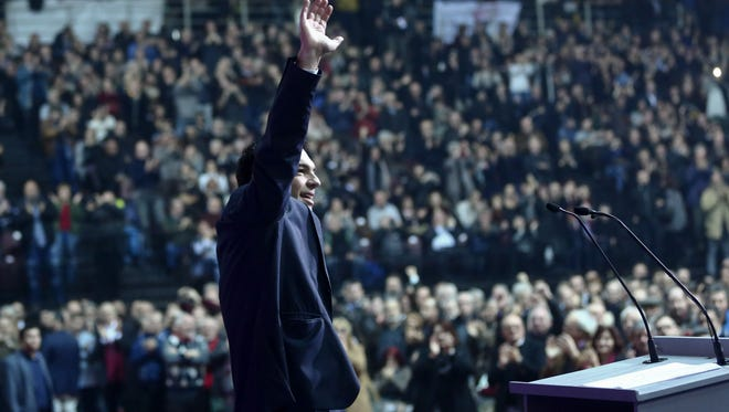 Greece's main opposition Syriza party leader Alexis Tsipras addresses his party's Congress in Athens on Saturday, Jan. 3, 2015. The Congress was convened to finalize the party's candidate lists for the upcoming Jan. 25 national elections, which Syriza is favored to win. (AP Photo/Petros Giannakouris)
