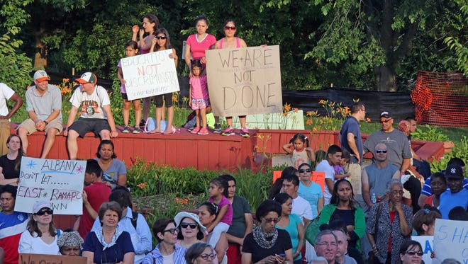 Local residents and supporters attend a rally to support a bill that would provide state oversight to the troubled school district as the legislative session nears its end at Memorial Park in Spring Valley June 22, 2015. Albany failed to pass a bill that would provide a monitor, and criticism followed.