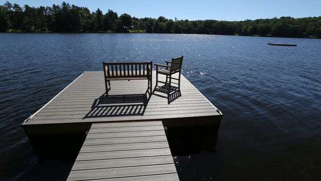 The dock on the lake of this South Salem Beach House on Truesdale Lake photographed June 24, 2015. It has been turned into a swank million-dollar home, using all recycled materials and keeping everything super-green.