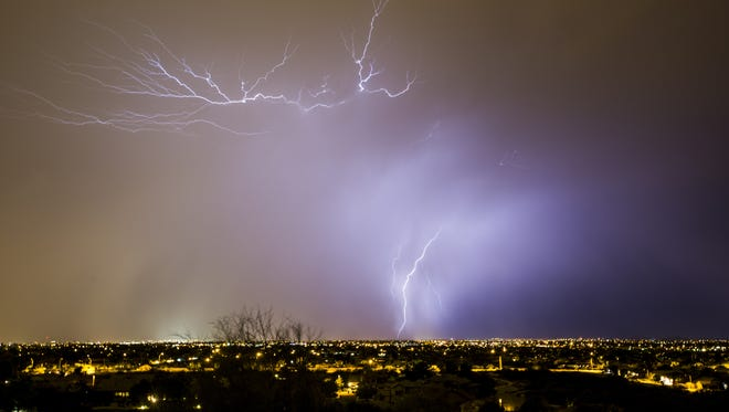 Lightning strikes in the West Valley as a monsoon storms sweeps over the Phoenix area, Monday, June 29, 2015.