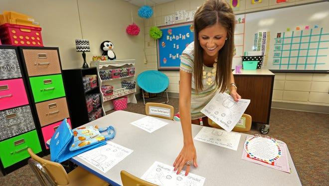 First grade teacher Danielle Kenworthy prepares her classroom before the students arrive on the first day of school at Rolling Green Elementary School in Urbandale on Thursday, July 24, 2014.