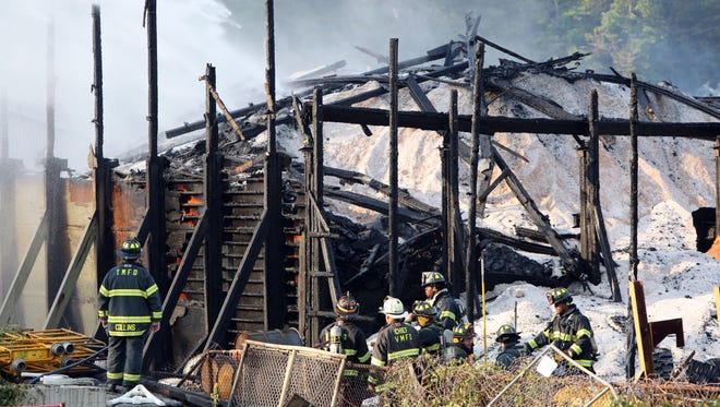 Firefighters battled a fire at the state Thruway Authority maintenance shed near the Larchmont-New Rochelle border, Aug. 18, 2015. About 100 firefighters from Larchmont, New Rochelle, the town and village of Mamaroneck, Scarsdale and Harrison were on the scene.