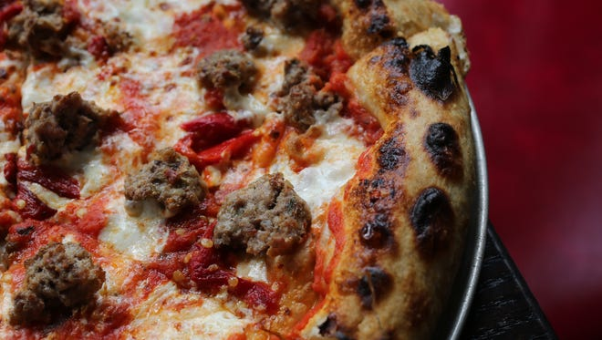 "The ""Lilly's"" pizza, with tomato sauce, mozzarella, house meatballs and pickled chiles at Lilly's Oyster Bar on Mamaroneck Avenue in White Plains, Aug. 25, 2015."