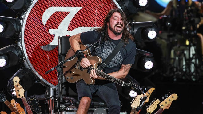 Dave Grohl rocks out with a broken leg atop his custom built throne during a The Foo Fighter's concert at Klipsch Music Center, Thursday August 27th, 2015.  Grohl broke his leg during a Foo Fighters concert in Gothenburg, Sweden. Grohl is an Ohio native.