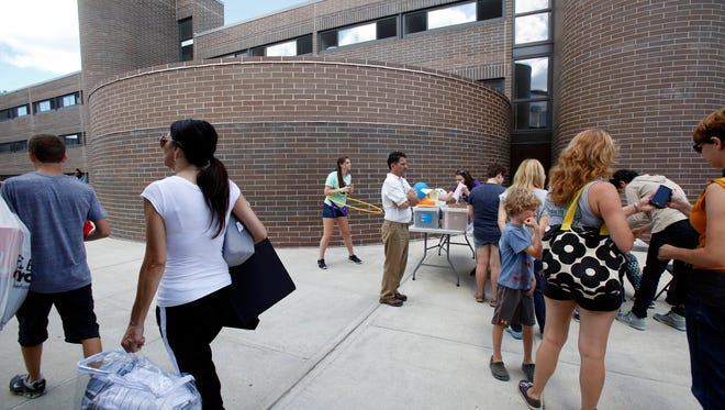 Students move into dorms at Purchase College, State University of New York, on Aug. 28, 2015.
