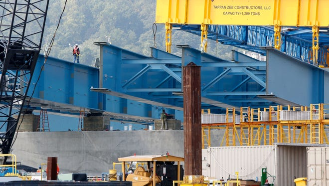 The Left Coast Lifter places a girder as they continue to construct the new Tappan Zee Bridge Sept. 2, 2015.