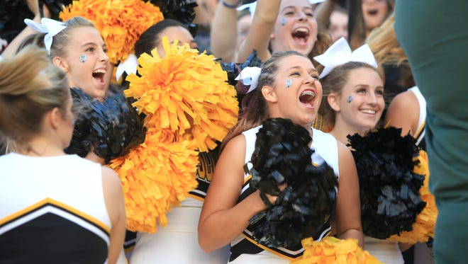 Tuscola's cheerleaders were part of the crowd Friday at Weatherby Stadium in Waynesville.