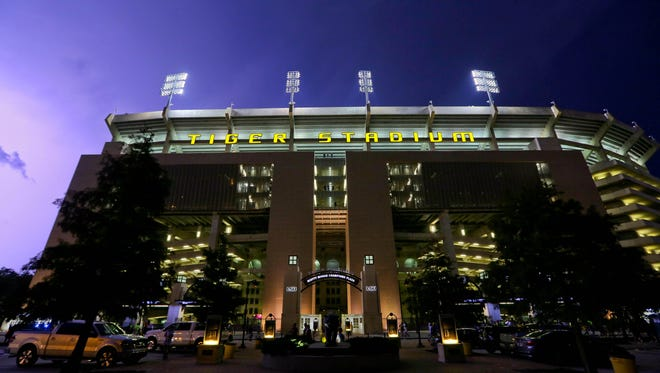 Lightning strikes outside during a weather delay for a game between the LSU Tigers and the McNeese State Cowboys at Tiger Stadium. The game was cancelled due to weather.