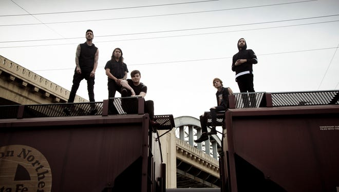 The members of Of Mice and Men, from left: Austin Carlile, Phil Manansala, Aaron Pauley, Alan Ashby and Valentino Arteaga.