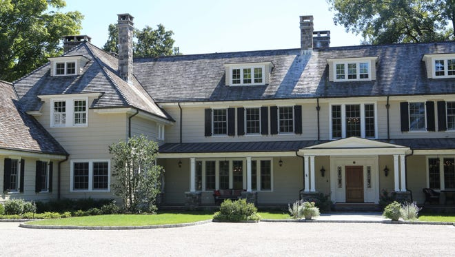 The exterior of the rebuilt and expanded 1905 Colonial in North Castle. The house was built by celebrity journalist Richard Harding Davis.