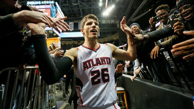 Atlanta Hawks guard Kyle Korver (26) greets fans after a game last season. More fans are turning out for games in Atlanta now.