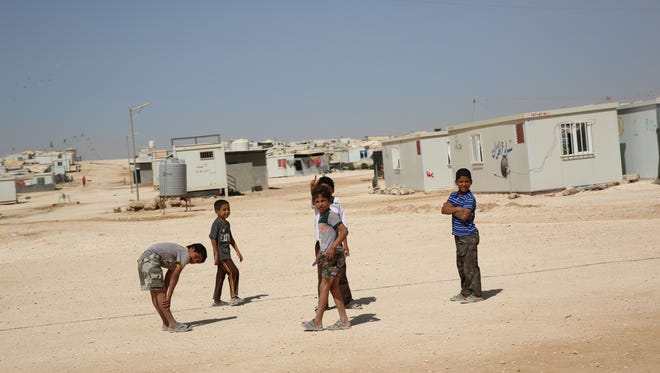 Children at Zaatari Refugee Camp, the largest in the Middle East, home to nearly 80,000 Syrian refugees spread over 5,000 acres.