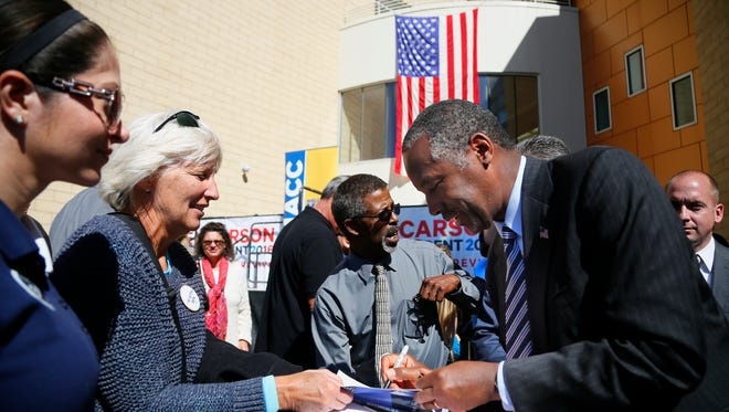 Republican presidential candidate Dr. Ben Carson greets supporters after a speech at DMACC in Ankey, Friday, Oct. 2, 2015, in Ankeny, Iowa.