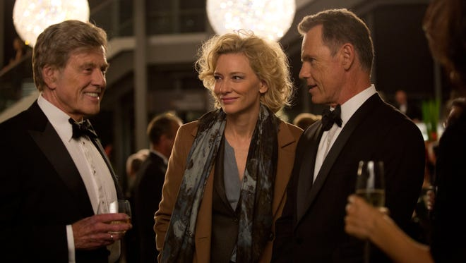 """Robert Redford portrays Dan Rather, from left, Cate Blanchett portrays Mary Mapes and Bruce Greenwood portrays Andrew Heyward in a scene from, """"Truth."""""""