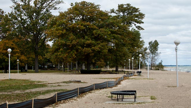 Land has been cleared where the old restroom facilities once stood Wednesday, October 14, 2015 at Lakeside Park in Port Huron. A new restroom and concessions facility and splash pad will be constructed and open by May of 2016 as part of improvements at the park.