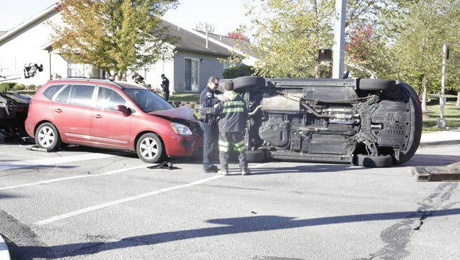 A three-vehicle crash Friday, Oct. 16, 2015 sent two to the hospital and overturned one SUV.