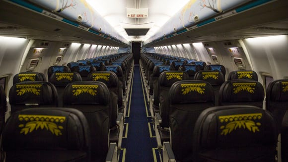 The interior of the plane goes from sunflowers to snow.