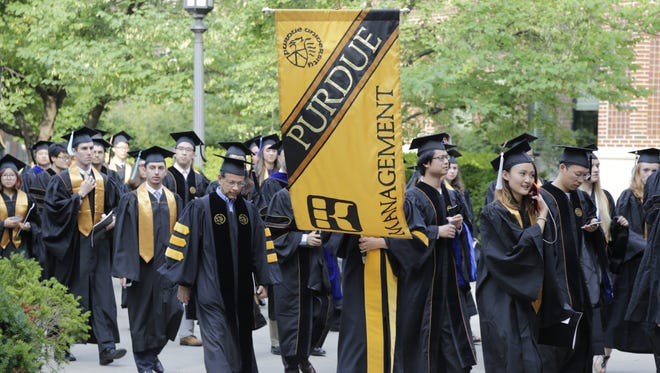 Graduates participate in Purdue University's 2015 summer commencement ceremony in August. The university is moving forward with income share agreements, a new way to fund tuition for graduates in the future.