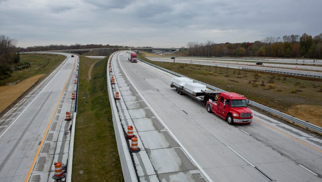 Vehicles travel along Interstate 69 Wedneday, October 21, 2015 in Port Huron Township. A ceremony to celebrate the completion of the $85 million project to reconstruct the I-94/I-69 interchange will be held at 11 a.m. Oct. 26 at the Port Huron Welcome Center.