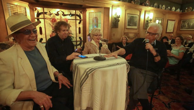 Jazz and pop singer Jack Jones shares a Frank Sinatra story with a Rat Pack panel made up of musician and actor Trini Lopez, left, Rita Vale the widow of Sinatra's friend Jerry Vale and Desert Sun reporter Bruce Fessier, second from the left, on Wednesday at Lord Fletcher's in Rancho Mirage.