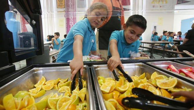 Cielo Vista Charter students get sliced oranges for lunch. The oranges were purchased by Palm Springs Unified School District from an organic farm in Redlands.