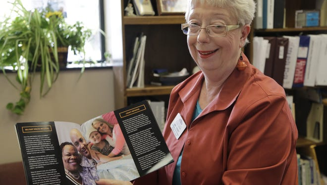 Amy Paget, assistant county librarian, holds StoryCorps promotional materials, Friday, Oct. 30, 2015, in her office in the downtown library. StoryCorps, a national oral history archivist, will come to county libraries in November.
