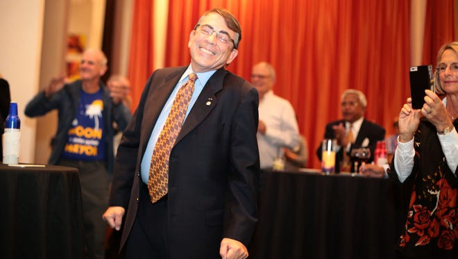 Palm Springs mayoral candidate Rob Moon reacts to early election results that shows his lead over other candidates at his election night party at the Hyatt in Palm Springs on Tuesday.