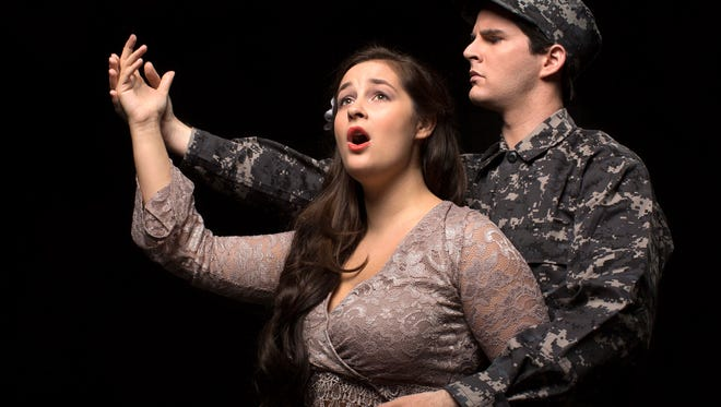 "Soprano Cassidy Thompson, a junior at the Eastman School of Music, and baritone Trevor Cook, a senior, perform in Eastman Opera Theatre's production of ""Hydrogen Jukebox."""