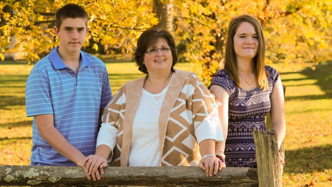 Karen Sauer adopted Dusten and Neven when they were 11 and 12. She  founded the mentoring group AdoptShine to help other adoptive and foster families.