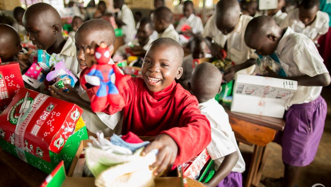 Children receive their Operation Christmas shoe boxes.