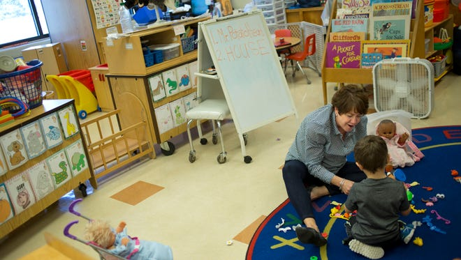 Paraprofessional Pam Thomas works with a student in a Early Childhood Special Education classroom Thursday, November 5, 2015 at Kimball Elementary School.