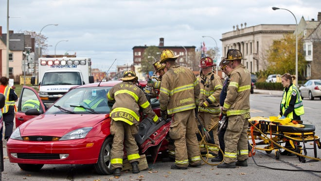 Members of the Port Huron Fire Department use extricate a man from a vehicle Friday afternoon at White and Military Streets in Port Huron. The man was transferred to McLaren Port Huron with injuries.