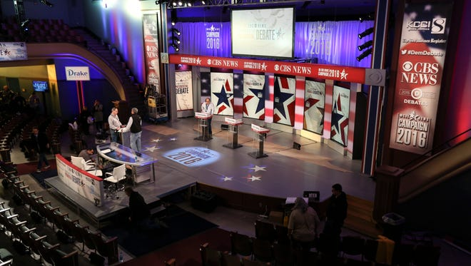 Workers test lighting during setup Friday Nov. 13, 2015, for the Democratic debate Saturday at Drake University in Des Moines, Iowa, featuring former secretary of state Hillary Clinton, Sen. Bernie Sanders and former Maryland Gov. Martin OÕMalley.