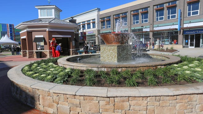 A new gazebo with fireplace and heaters can warm up guests visiting The Shops at Perry Crossing, formerly Metropolis Lifestyle Center, Friday November 13th, 2015. The outdoor mall has undergone a$11.1 million redevelopment and rebranding.
