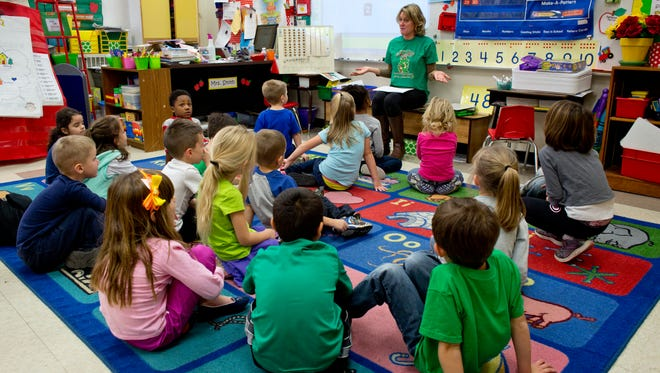 Kindergarten teacher Susie Smith leads her class in a counting exercise Friday, November 13, 2015 at Garfield Elementary School. An upcoming bond proposal could include converting existing classrooms at Garfield into larger kindergarten classrooms with attached bathrooms.