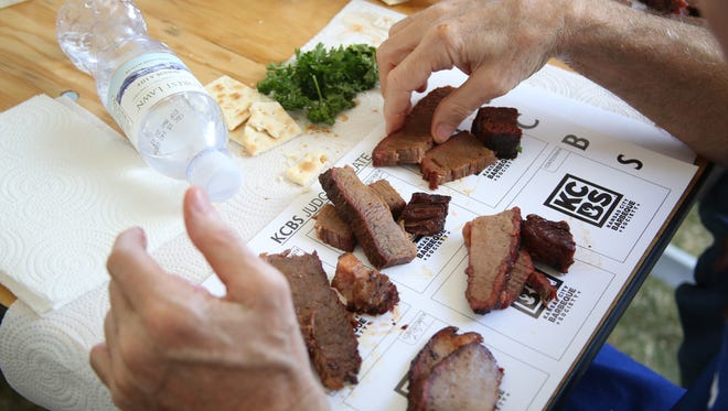 California State BBQ Championship took place at the Indio Golf Course with 50 teams participating for a $10,000 grand prize. In this photo a judge has his hands full in order to judge.