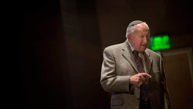 Holocaust survivor Martin Lowenberg, 88, speaks about his experience living in Nazi Germany Wednesday, November 18, 2015 at Marysville High School.