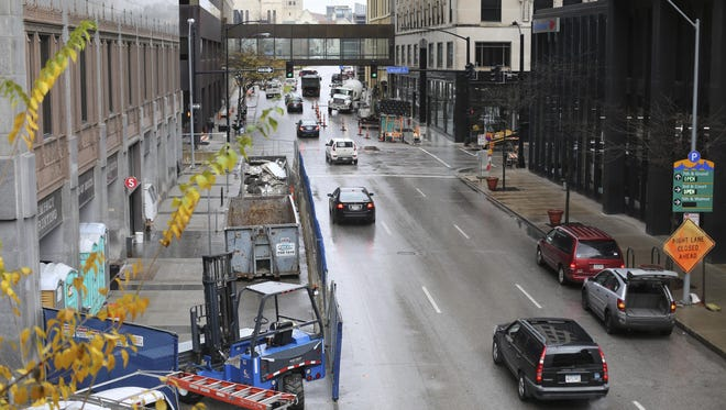 Sidewalk closures along 6th Street between Walnut Street and Grand Avenue in downtown Des Moines, Iowa.