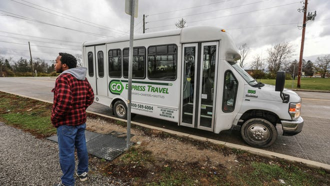 First-time shuttle service user Terrance Turner waits for the Plainfield connector shuttle service.