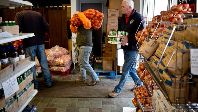 Marysville DPW foreman Brian Wilson delivers food to the SOS Marysville Food Pantry along with other employees Tuesday, December 1, 2015 at 2929 Gratiot Boulevard.