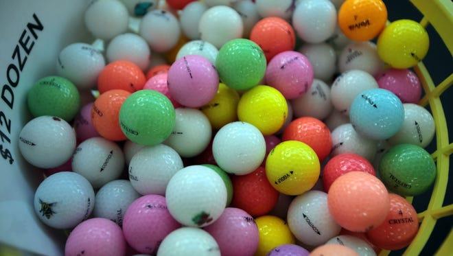 Paul Clayborn's stall sells golf balls at the COD Street Fair in Palm Desert.