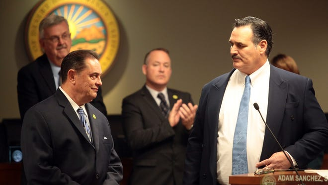 Mayor Pro Tem Russell Betts thanks Mayor Adam Sanchez for his work as incoming mayor Scott Matas, center, looks on Tuesday during the swearing in ceremony for the new Desert Hot Springs mayor and city Council.