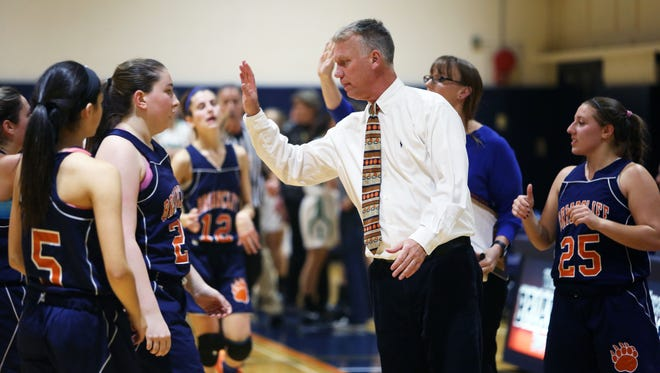 Briarcliff girls basketball head coach Don Hamlin high-fives players during a game against Irvington. Dec. 1, 2015.