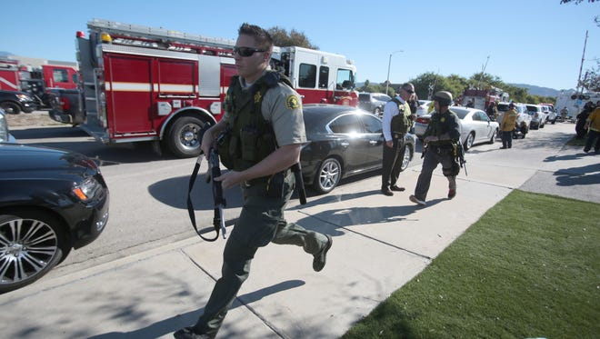 Law enforcement converge on the site of an active shoot on S. Waterman Ave in San Bernardino on Wednesday.