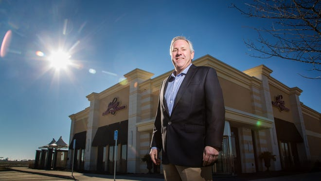 Mike Whalen, President of Heart of America stands for a portrait in front of the new Johnny's Italian Steak House in Altoona Friday, Dec. 4, 2015.