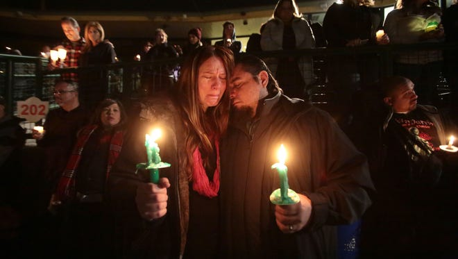 Roy Trules Jr. and Jennifer Trules, friends of Aurora Godoy, who died in the mass shooting in San Bernardino on Dec. 2, attend a candlelight vigil at San Manuel Stadium.