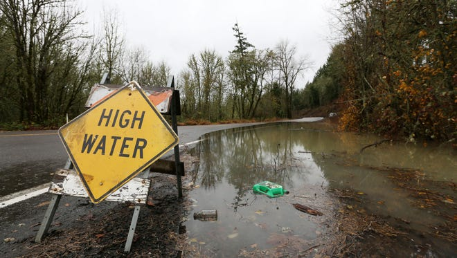 High water along Old Fort Road south of Monmouth on Tuesday, Dec. 8, 2015.